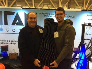 Image: 3DVinyl™ co-inventors Greg Harrison, Specialist on Additive Manufacturing materials and Dennis Planner, 3DVinyl™ Product Manager, Chemson Pacific hold the completed 3DVinyl™ vase.